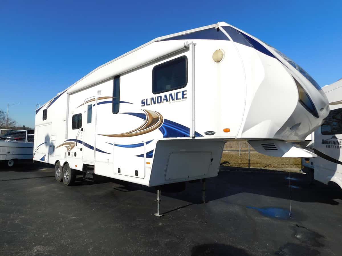 USED 2011 Heartland SUNDANCE 3300CK - Rick's RV Center